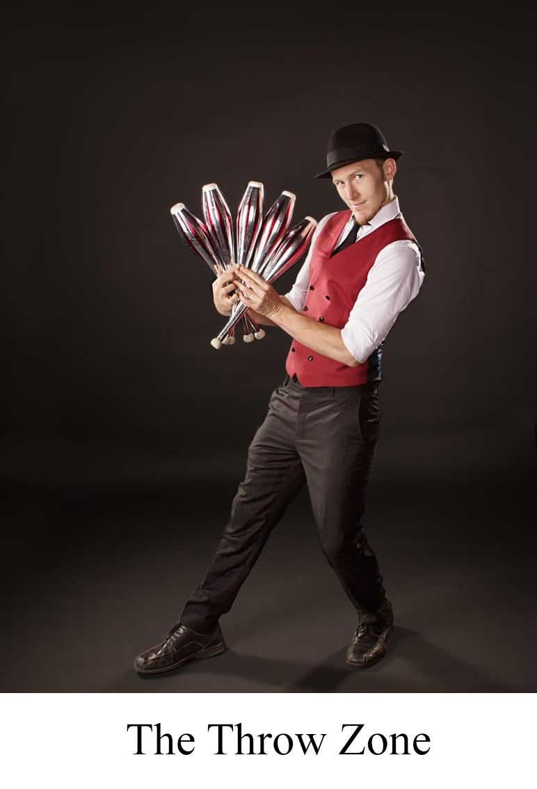 Photo of Jeremiah Johnston from The Throw Zone with Juggling Clubs